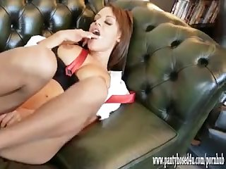 Horny redhead teases in pantyhose and heels as she plays with her wet pussy